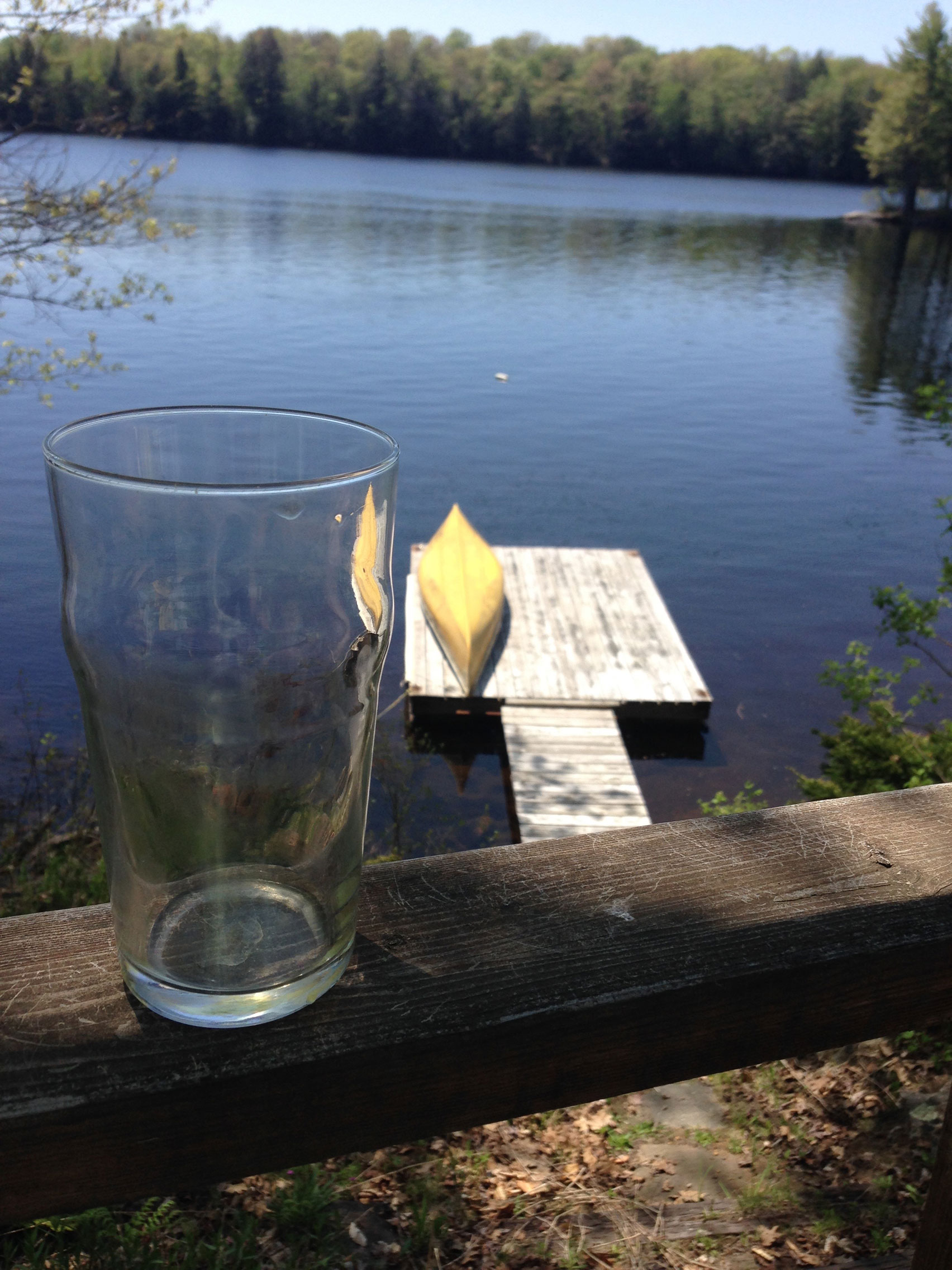 beer glass, canoe and lake