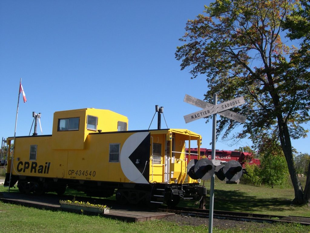 yellow cp rail caboos on display in park