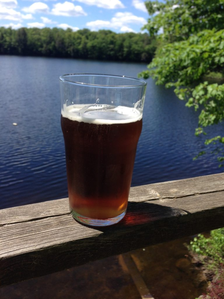 glass of beer at the lake