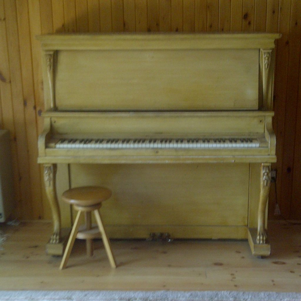 light coloured piano in a cottage