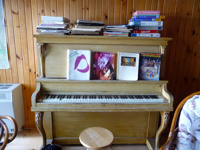 Piano Full of books and puzzles