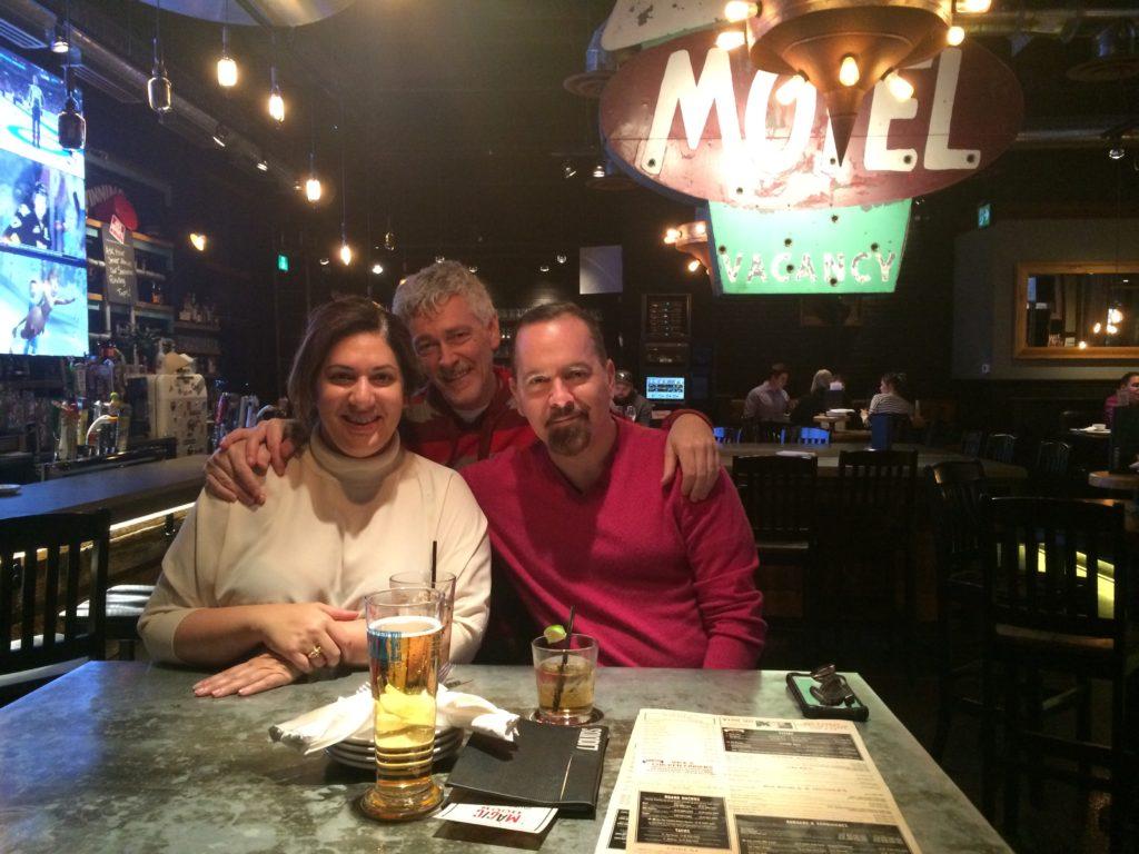 three friends at a bar