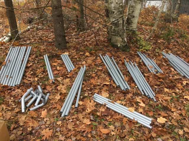 Metal poles on a leafy ground