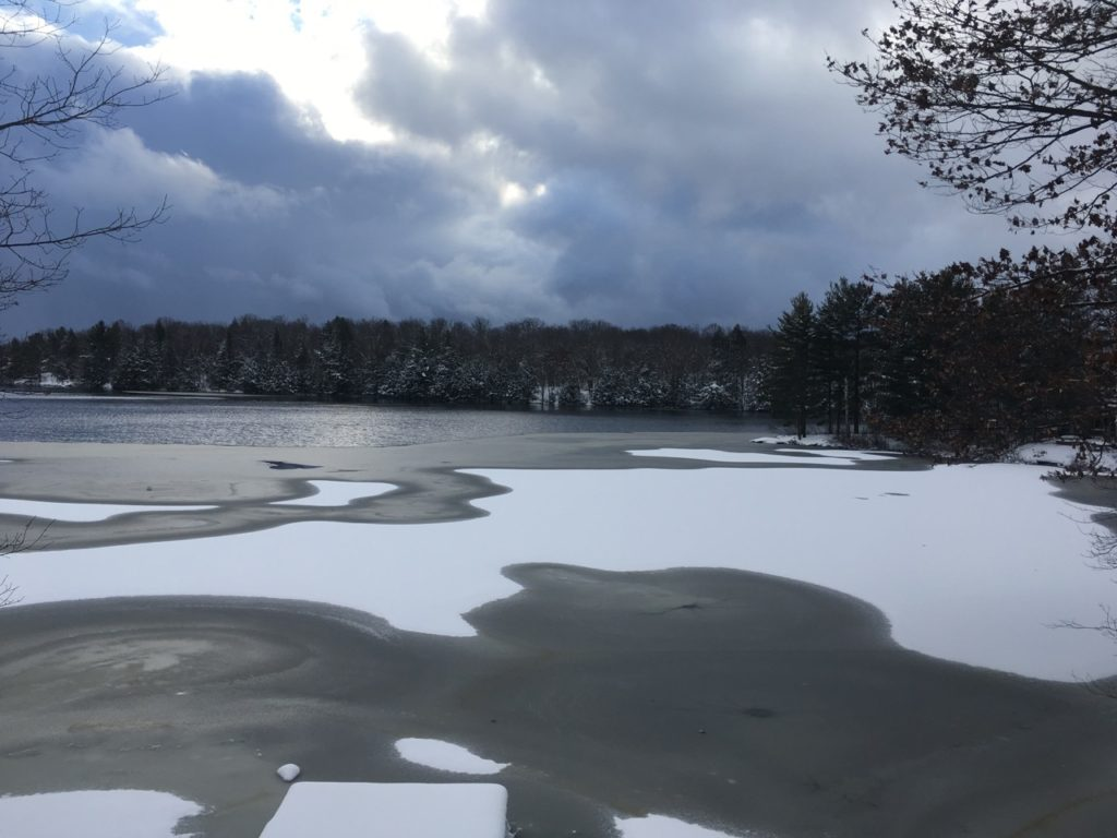 snow and ice on lake