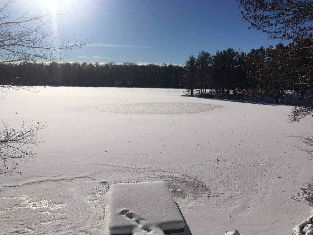 ice and snow covering lake