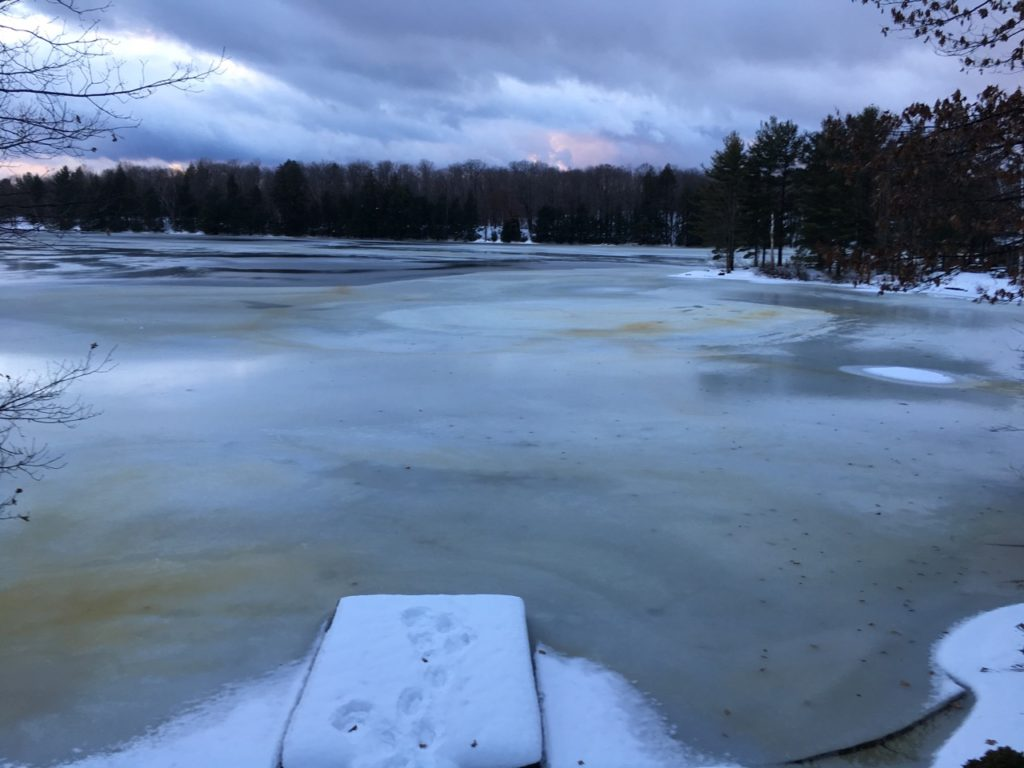 wet lake with a little snow