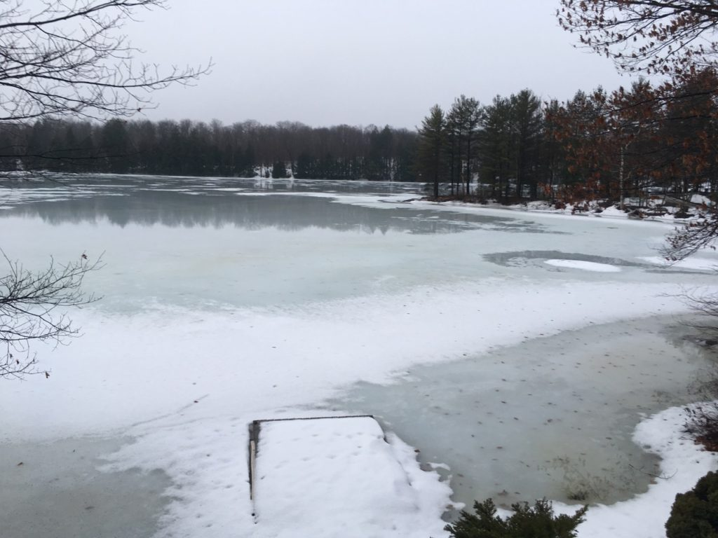 icy lake with open water