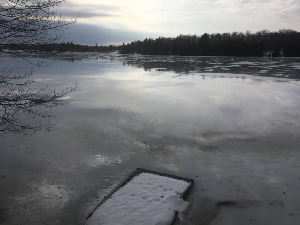 snow melting from lake