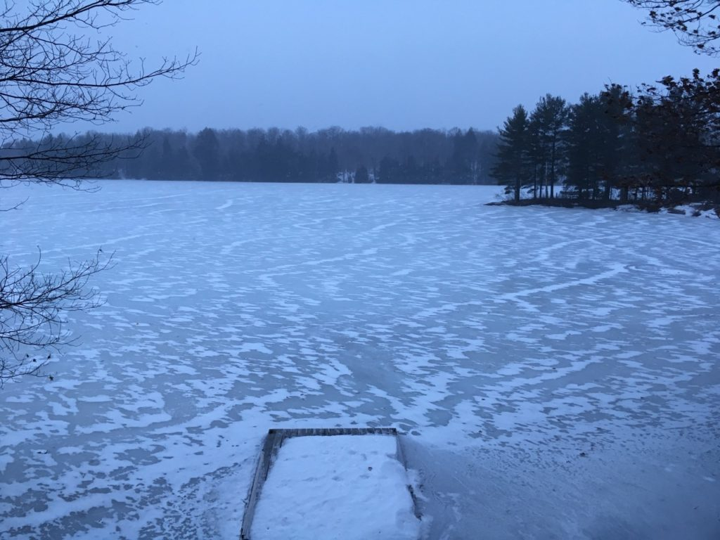 snow ripples on icy lake