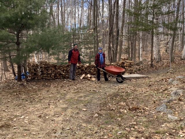 Couple stacking wood